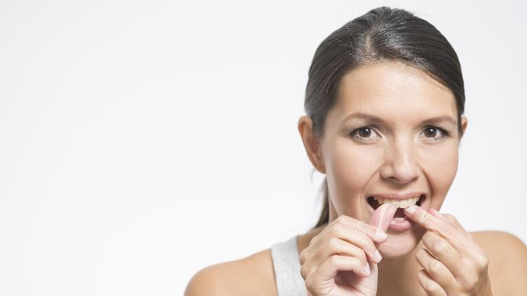 Woman Putting in Clear Aligner | ClearCorrect in Cumberland
